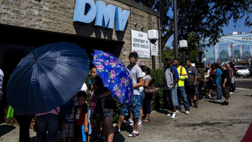 A line of people stretches around the South L.A. location of a California Department of Motor Vehicles Office on Aug. 7.