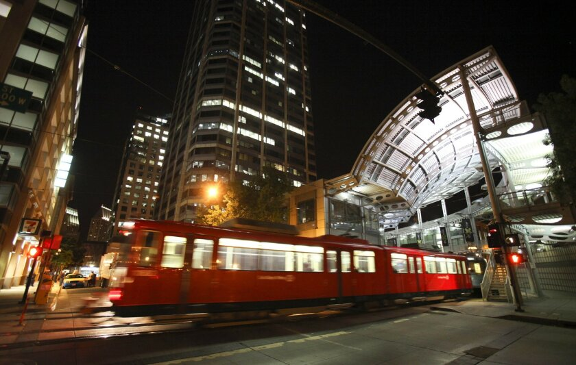A San Diego trolley pulls into downtown at America Plaza. U-T San Diego file photo.