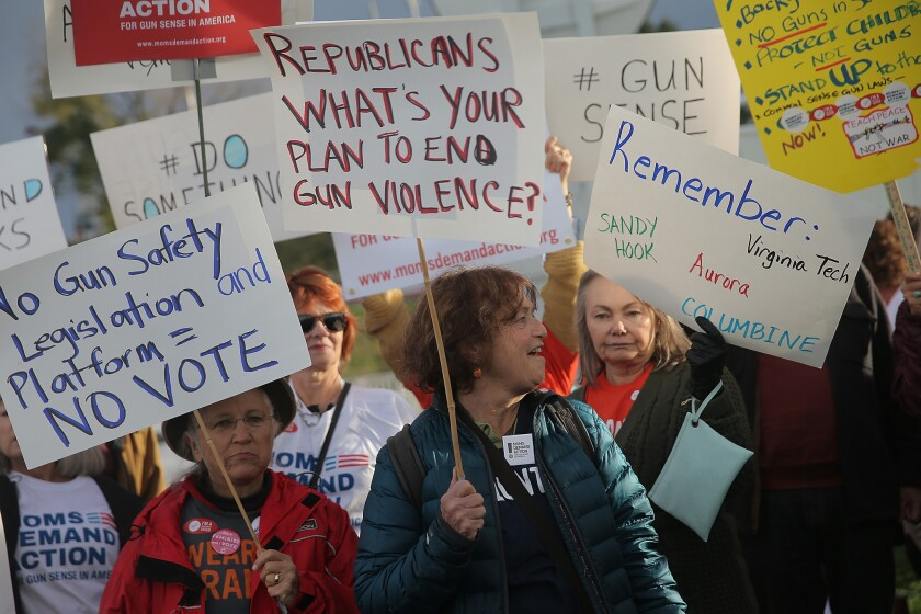 Activists in support of stricter gun laws protest outside the CNBC Republican Presidential Debate on Oct. 28 in Boulder, Colo.