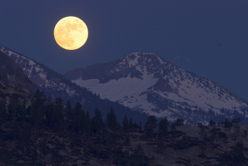 """A """"honey moon"""" in 2010, as seen from Yosemite National Park."""