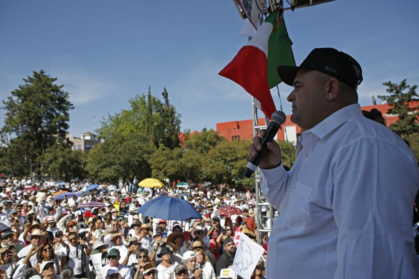 Julian LeBaron speaks during a protest against the first year in office of Mexico's President Andres Manuel Lopez Obrador, in Mexico City, Monday, Dec. 1, 2019. LeBaron joined a protest on Reforma avenue to expressed anger and frustration over increasingly appalling incidents of violence, a stagnant economy and deepening political divisions in the country. (AP Photo/Ginnette Riquelme)