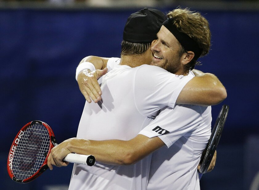Andy Roddick, left, and Mardy Fish, celebrate their win over Yen-Hsun Lu and Jonathan Marray in a first round doubles match at the Atlanta Open tennis tournament, Wednesday, July 29, 2015, in Atlanta. (AP Photo/David Goldman)