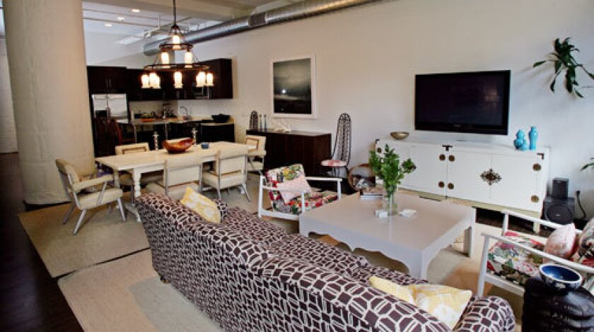 The living-dining-kitchen space in interior designer Jennifer Culp's home at the Broadway Hollywood lofts.