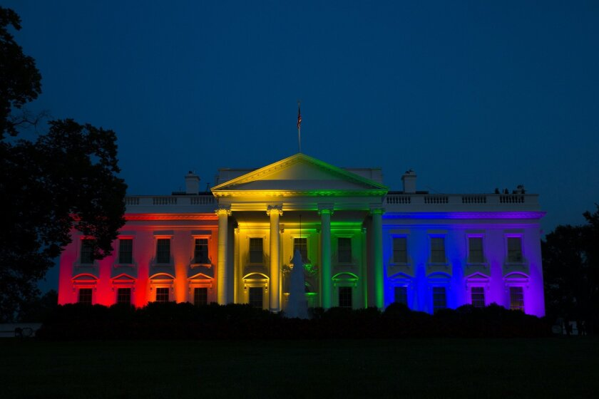 The White House is illuminated in celebration after the Supreme Court ruled that the Constitution guarantees a right to same-sex marriage, on Friday, June 26, 2015, in Washington. (AP Photo/Evan Vucci)