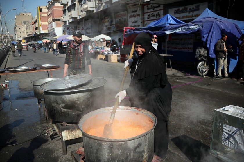 Volunteers prepare free food to anti-government protesters during ongoing demonstrations in Tahrir Square, Baghdad, Iraq, Wednesday, Feb. 5, 2020. (AP Photo/Hadi Mizban)