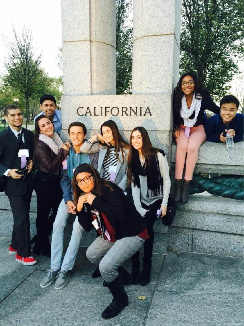 """Cole Chodorow (pictured left in blue dress shirt) and Sophia Bond (pictured directly under the last """"A' in California). Courtesy photo"""
