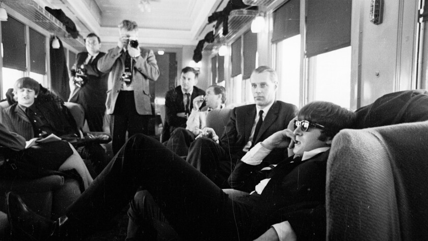 """Ringo Starr, left, George Martin and John Lennon on a train between New York and Washington, D.C., in a scene from the documentary """"The Beatles: Eight Days a Week — The Touring Years."""""""
