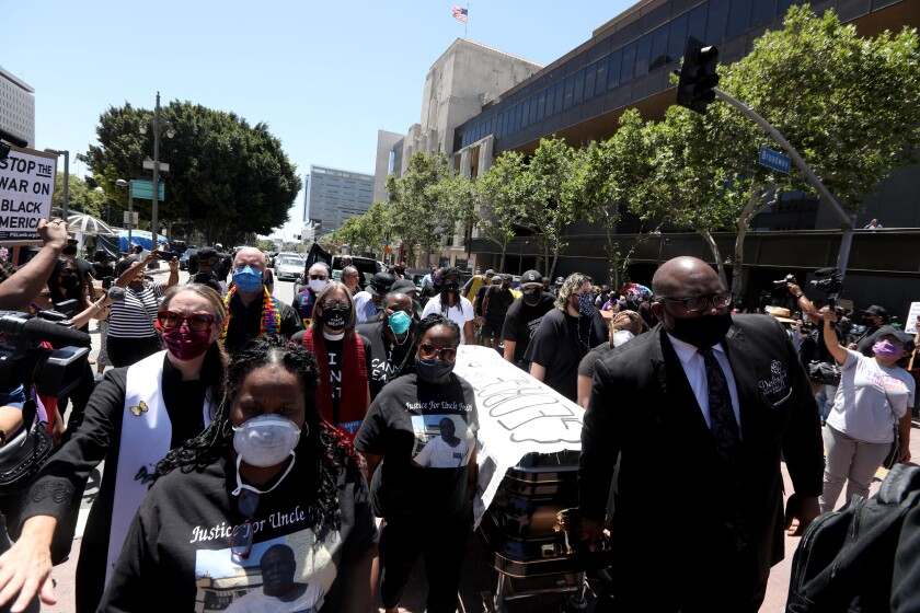 A coffin is carried in honor of George Floyd at a Black Lives Matter-L.A. memorial service and funeral procession Monday.