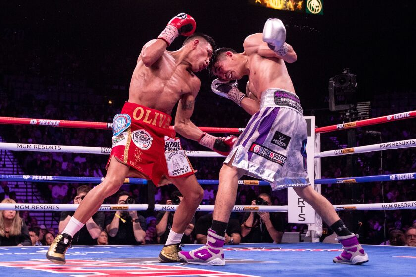 Leo Santa Cruz of Mexico in action against Miguel Floresduring their World Boxing Association world super featherweight championship fight on Saturday in Las Vegas.