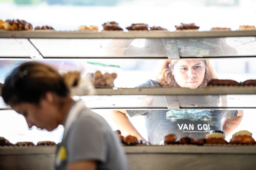 A customer browses the selection of doughnuts at the Donut Man in Glendora.