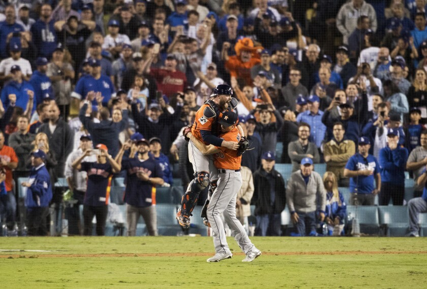 The Houston Astros celebrate after beating the Dodgers to win the World Series at Dodger Stadium in 2017.