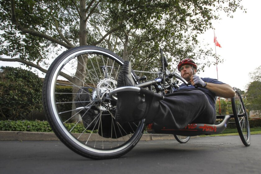 Juan Carlos Vinolo rides his handcycle near his home in La Jolla.