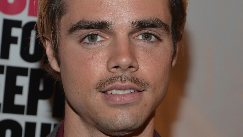 Reid Ewing marvels at his sexuality getting more attention than cosmetic surgery article