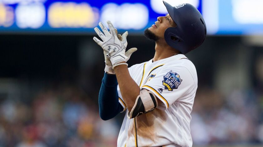 San Diego Padres shortstop Jose Rondon celebrates his first major league hit after hitting a single in the 5th.