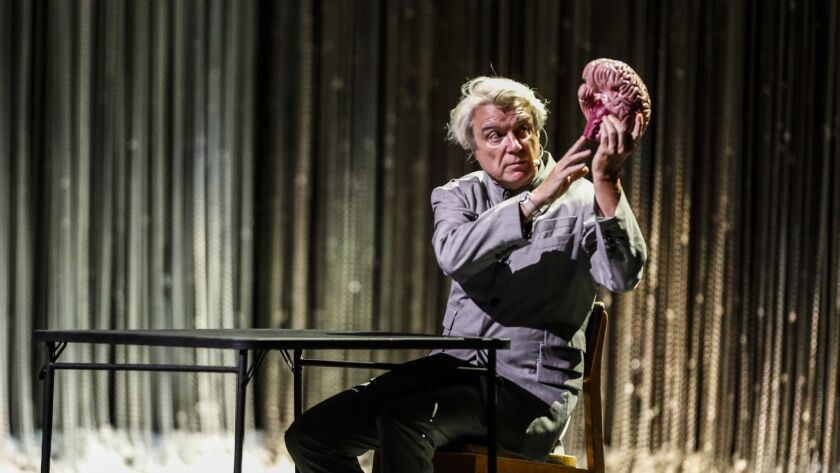 """David Byrne employed a model of a human brain to illustrate his song """"Here"""" in concert at the Shrine Auditorium in Los Angeles on Saturday."""