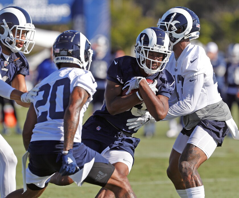 Rams running back Justin Davis carries the ball at training camp on July 27, 2019.