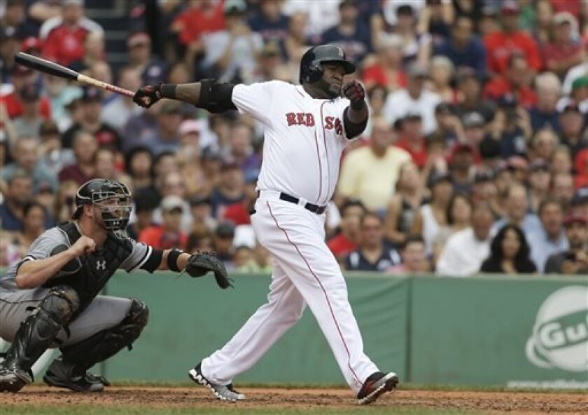 Boston Red Sox's David Ortiz, right, hits an RBI double off a pitch by Chicago White Sox pitcher Andre Rienzo as White Sox catcher Tyler Flowers, left, looks on in the second inning of a baseball game at Fenway Park, in Boston, Sunday, Sept. 1, 2013. (AP Photo/Steven Senne)