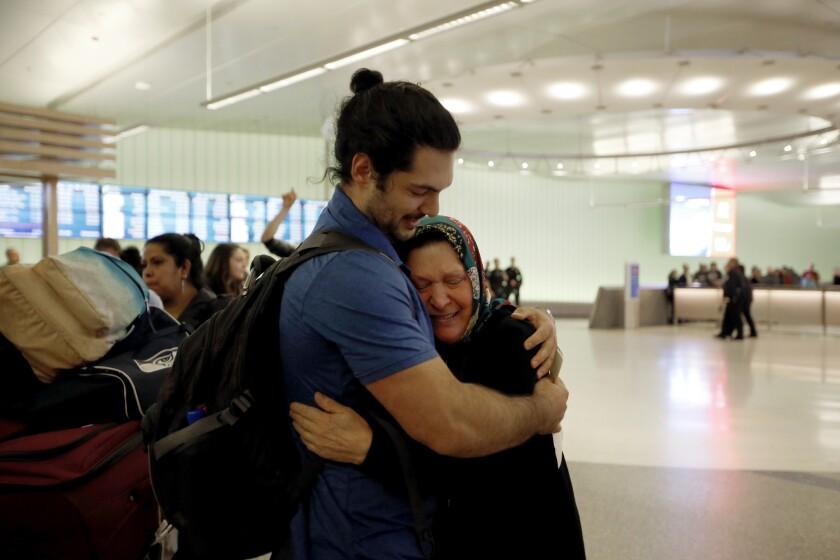 Siavosh Naji-Talakar greets his grandmother, Marzieh Moosavizadeh, 75, at LAX's Tom Bradley International Terminal. She was detained upon arriving from Iran.