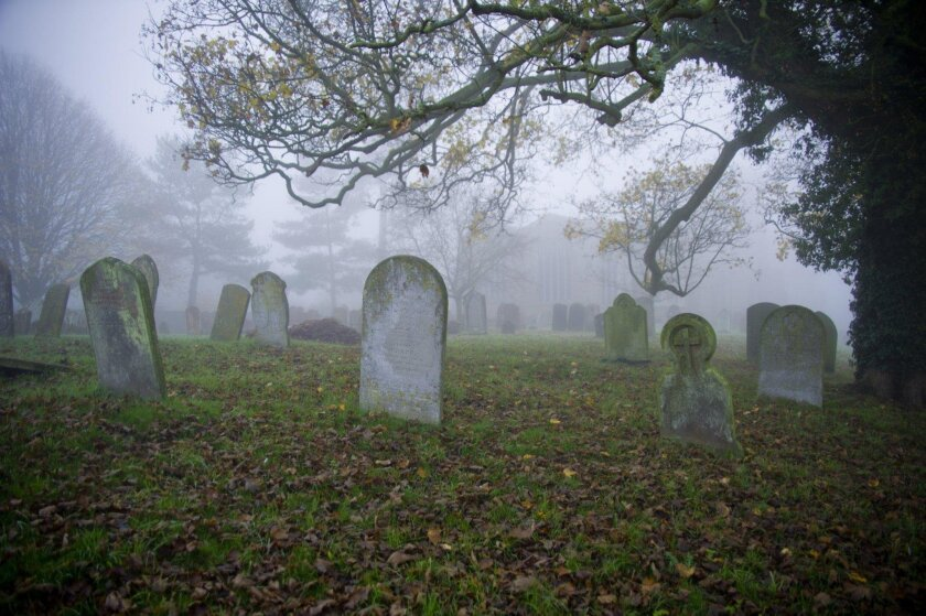 Cemetery shrouded in fog.