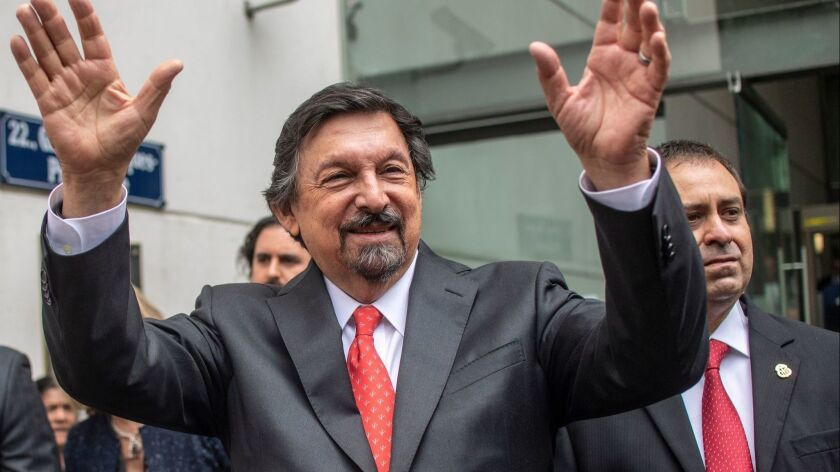 Napoleon Gomez Urrutia, a controversial Mexican mining leader who fled to Canada while facing accusations of fraud, returned home be sworn in as a senator for Morena, the party of leftist President-elect Andres Manuel Lopez Obrador.