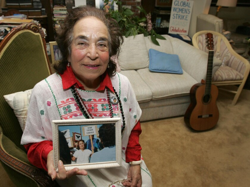 Gracia Molina de Pick in 2005, holding a photo her as an activist in Mexico