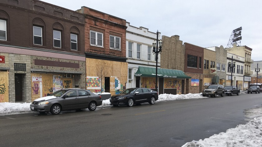 Windows are boarded up in Kenosha, Wis., Thursday, Jan. 7. 2021. The chaotic protests that everyone feared would ensue after a prosecutor decided this week not to charge a Wisconsin police officer who shot Jacob Blake, a Black man, in the back haven't materialized as activists bide their time after right-wing extremists stormed the U.S. Capitol. (AP Photo/Mike Householder)