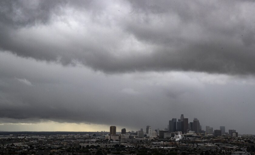 Storm clouds roll over the Los Angeles Basin and downtown skyscrapers