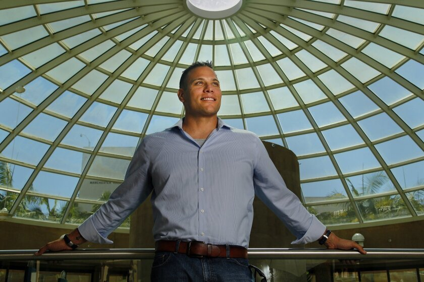 Clay Treska stands in the dome next to the Love Library at SDSU. Treska is one of 23 recipients of the CSU Trustees' Award for Outstanding Achievement.