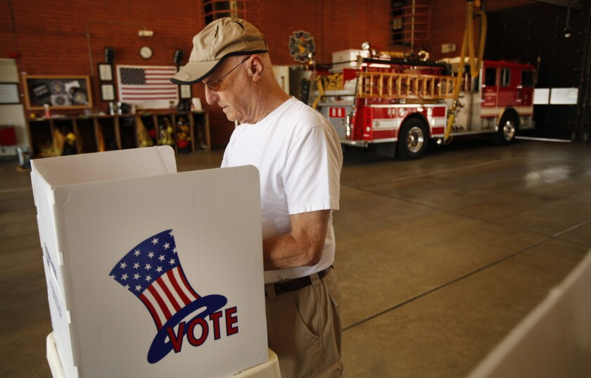 Tom Smalley casts his ballot in the Los Angeles City Fire Station 88 in Sherman Oaks.