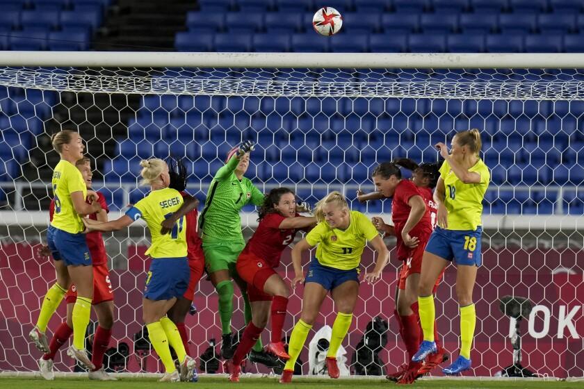 Canada's goalkeeper Stephanie Labbe blocks a shot in the women's soccer match for the gold medal against Sweden at the 2020 Summer Olympics, Friday, Aug. 6, 2021, in Yokohama, Japan. (AP Photo/Fernando Vergara)
