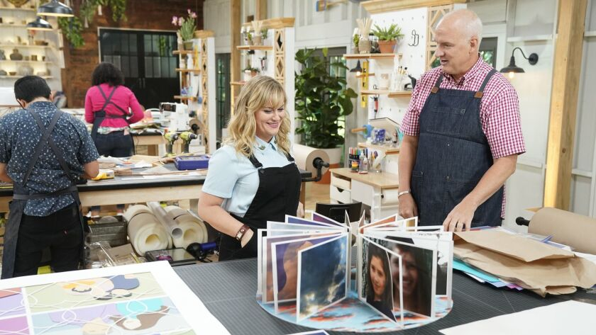 "In the debut episode of NBC's ""Making It,"" co-host Amy Poehler checks in on contestant Jeffery Rudell and his take on a family photo album. The show airs Tuesdays at 10 p.m. on NBC."