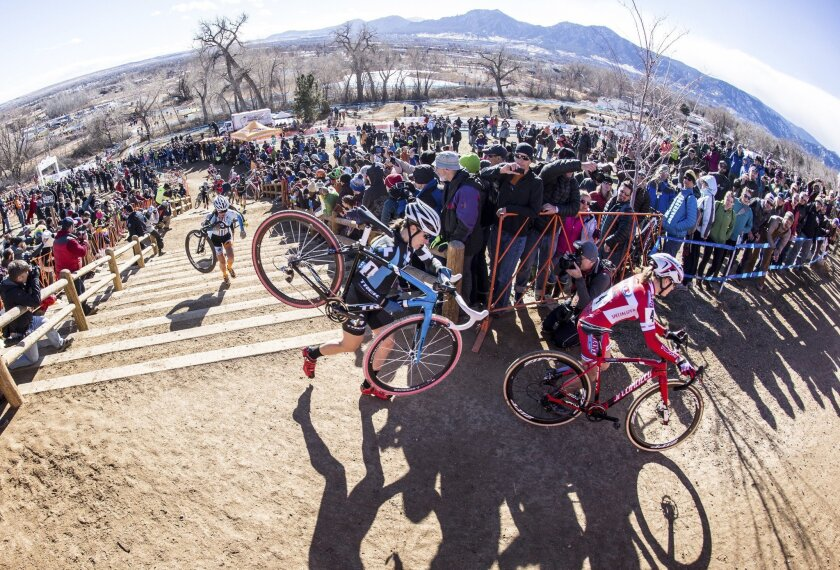 ADVANCE FOR WEEKEND EDITIONS, FEB. 1-2 - In this image taken with a fisheye lens on Jan. 12, 2014, and released by USA Cycling, Katie Compton, center, carries her bike up an incline during the women's elite division at the USA Cyling cyclo-cross national championship in Boulder Colo.  unique blend