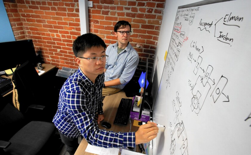 David Kim, left, and Jacob Bradsher work at AKAStudy's Santa Monica office. The company set up shop in the U.S. partly to improve its ability to recruit to be a more attractive employer to South Korean engineers who wanted to educate their children in the U.S.
