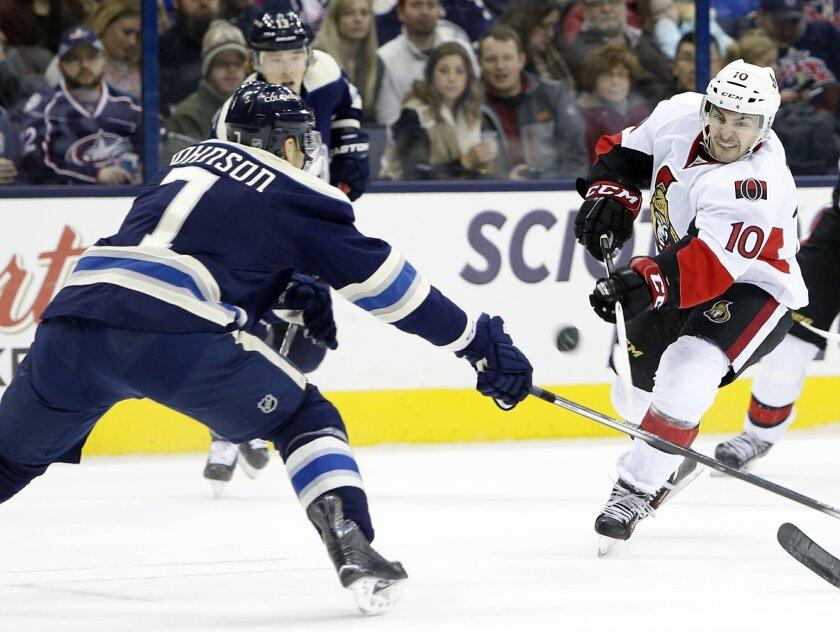 Ottawa Senators' Shane Prince, right, shoots past Columbus Blue Jackets' Jack Johnson during the first period of an NHL hockey game Saturday, Feb. 13, 2016, in Columbus, Ohio. (AP Photo/Jay LaPrete)