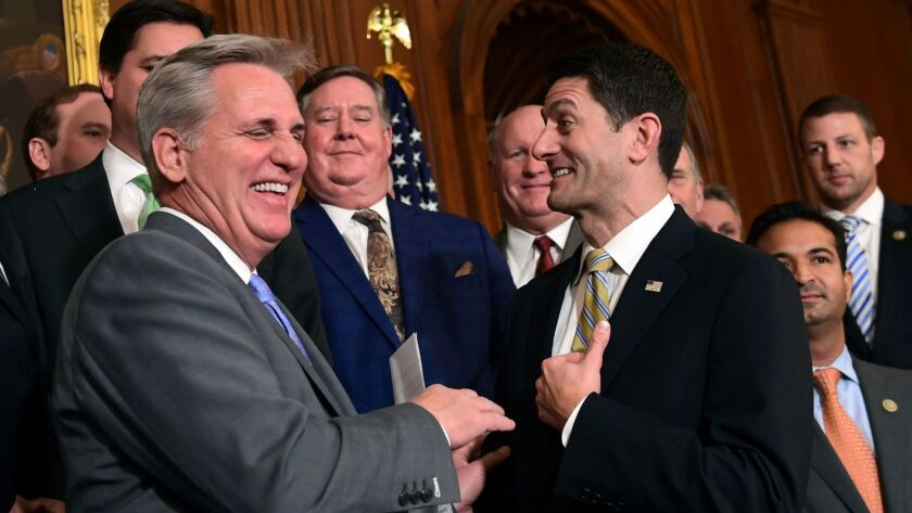 House Majority Leader Kevin McCarthy, (R-Bakersfield) and Speaker Paul Ryan (R-Wis.) congratulate each other last week on passing a tax bill that cuts taxes on the rich at the expense of the middle- and working-class.