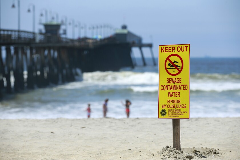 Signs warn of contaminated ocean water in Imperial Beach on May 30.