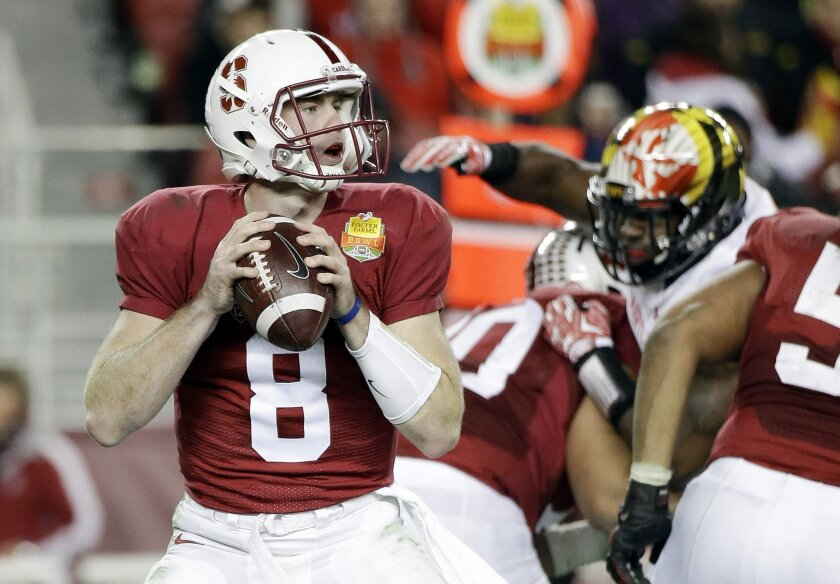Stanford quarterback Kevin Hogan looks to pass against Maryland during the second half of the Foster Farms Bowl NCAA college football game Tuesday, Dec. 30, 2014, in Santa Clara, Calif. Stanford won 45-21. (AP Photo/Marcio Jose Sanchez)