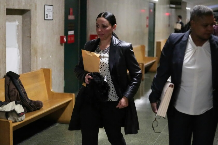 NYPD Detective Michelle Gangi is seen in the hallway after testifying in the trial of James Rackover on Tuesday in New York.