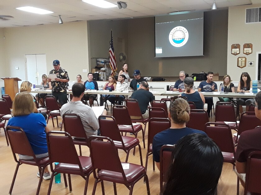 The Ocean Beach Town Council moves the agenda along at its Aug. 28 meeting at the Masonic Lodge.