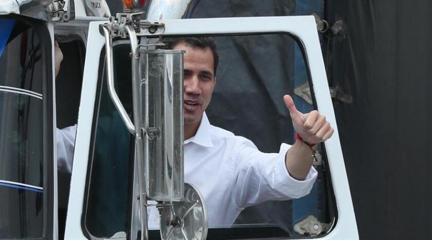Venezuela's interim president, Juan Guaido, greets supporters from a truck carrying humanitarian supplies in Cucuta, Colombia, on Feb. 23, 2019. EPA-EFE/Mauricio Dueñas Castañeda