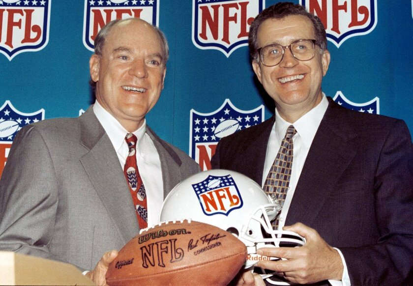 FILE - Houston businessman Bob McNair, left, and NFL commissioner Paul Tagliabue smile during a press conference in Atlanta, in this Wednesday, Oct. 6, 1999, file photo. Houston rejoined the NFL, paying a record $700 million for an expansion franchise. During Paul Tagliabue's 17-year stint as commissioner, the NFL experienced labor peace, saw skyrocketing television deals, construction of new stadiums across the nation and expansion to the current 32-team makeup. Despite those credentials that continued pro football's surge to the top of American sports, it took until a special centennial class in 2020 for Tagliabue to be voted into the Pro Football Hall of Fame after retiring in 2006. (AP Photo/W. A. Harewood, File)