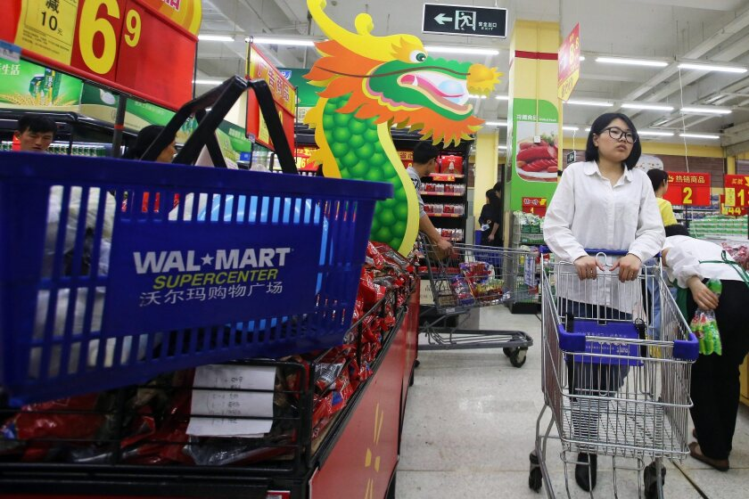 A Chinese consumer shops in a Wal-Mart super-center in Qingdao, in eastern China's Shandong province.