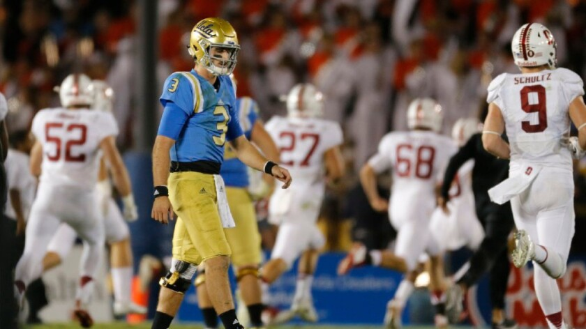 UCLA quarterback Josh Rosen walks off the field after fumbling the ball away on the final play of the game against Stanford on Sept. 24.
