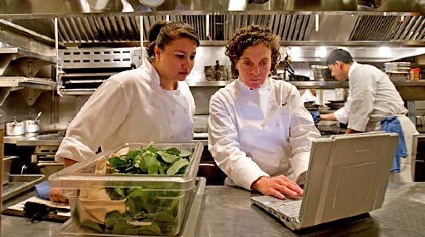 CLICK: Traci des Jardins, right, gets online with one of her chefs, Anastacia Quinones, at Jardiniere in San Francisco.