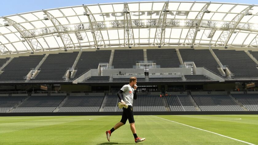 LOS ANGELES, CALIFORNIA APRIL 18, 2018-An LAFC player warms-up during practice at the new soccer sta