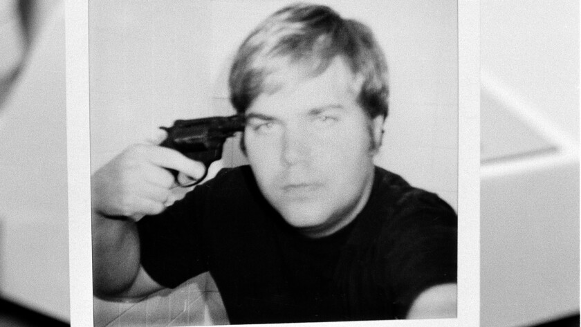John W. Hinckley Jr., who attempted to assassinate President Ronald Reagan in March 1981, holds a pistol to his head in this self–portrait obtained from court records.