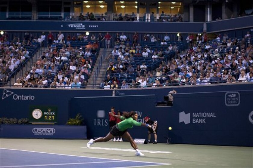 Serena Williams, of the United States, stretches for a shot during her victory over Lucie Safarova, of the Czech Republic, during the Rogers Cup tennis tournament in Toronto on Friday, Aug. 12, 2011. (AP Photo/The Canadian Press, Chris Young)