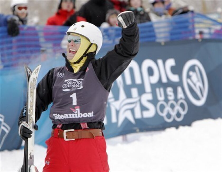 FILE - In this Dec. 24, 2009, file photo, Jeret Peterson, of Boise, Idaho, raises his arm and reacts at the bottom of the landing arena during the Olympic Trials Aerials skiing event in Steamboat Springs, Colo. (AP Photo/Nathan Bilow, File)