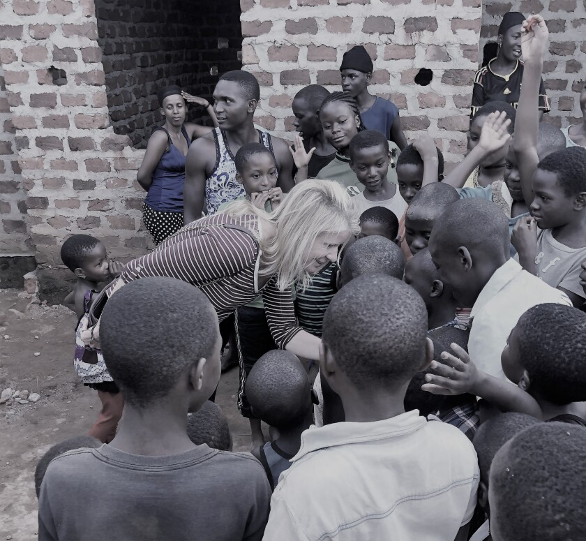 Jaye Connolly-LaBelle with children at the Wembly Mo Orphanage in Uganda.