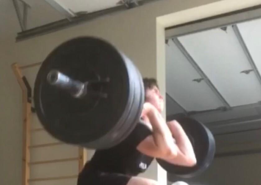 Patrick Grazer, a Sherman Oaks Notre Dame student, works on improving his strength.